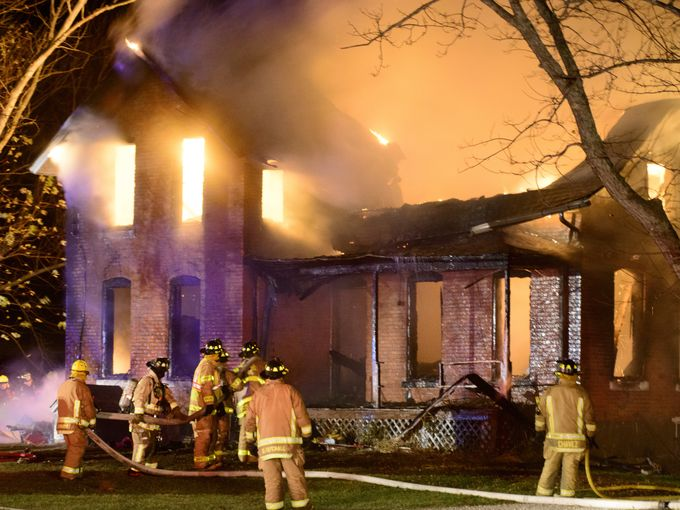 Firefighters from nine area fire departments battle a house fire near the village of Rocky Ridge, about five miles northwest of Oak Harbor in Ottawa County. Strong winds gusting up to 50 mph made it tougher for firefighters trying to contain the blaze, which engulfed the single-family house.