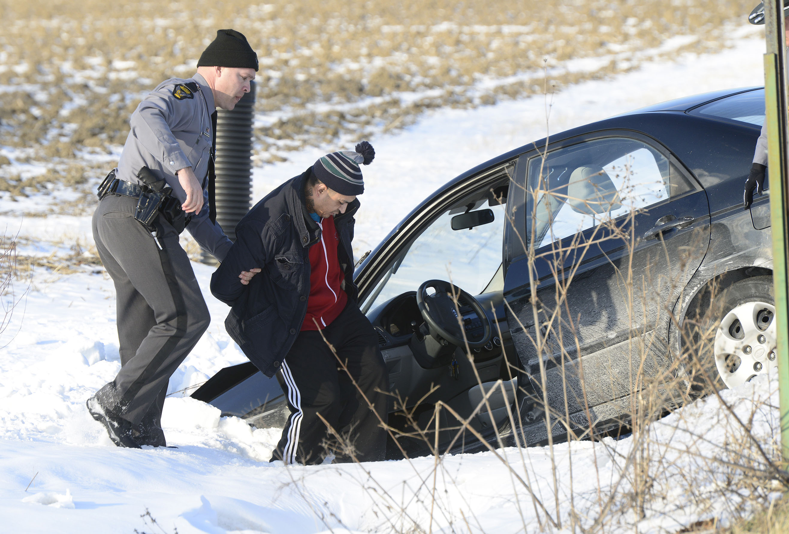 Ismael Gonzalez, 38, of Findlay is arrested on a felony warrant after leading police on a high speed chase across three counties, ending with parts flying off the car and a crash into a ditch at the corner of County Roads 153 and 106 in Lindsey on Tuesday, Jan. 19, 2106.