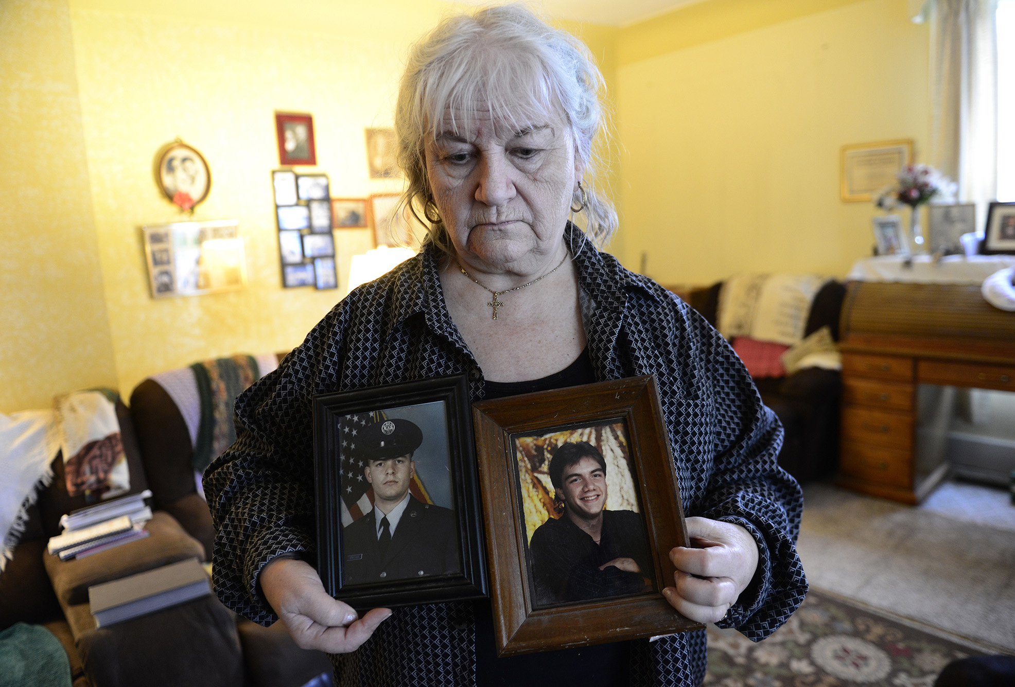 Lois Waggoner, 73, of Fremont holds photos of her two sons who died, contributing to her suicidal thoughts. She said she's has been hospitalized four times for manic episodes and five or six times for severe depression.