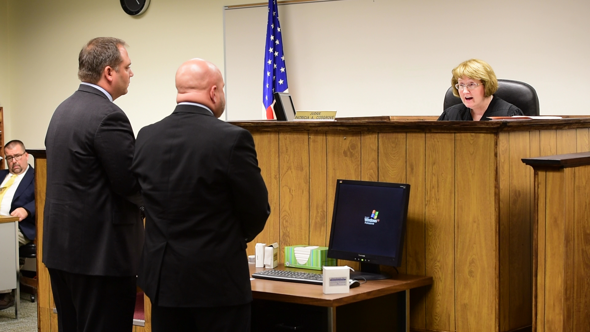 Visiting Judge Patricia Cosgrove, right, tells Sandusky County Sheriff Kyle Overmyer, middle, and his attorney Andy Mayle that she is revoking Overmyer's bond and sending him to jail for violating his bond conditions.