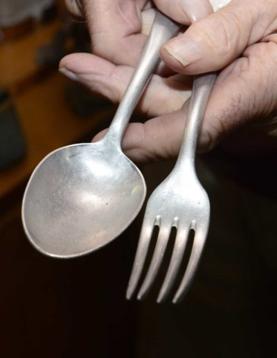 Charles Holcomb kept the silverware he used in prison camp during WWII.