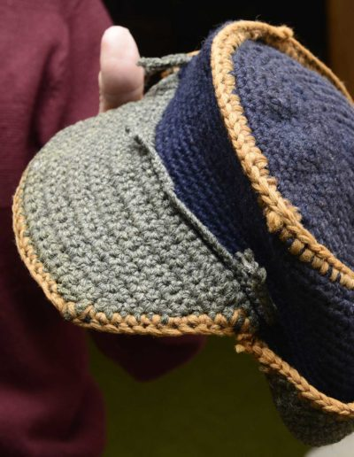 A prisoner from Iowa taught Charles Holcomb how to knit this cap he made in prison camp from an unraveled sweater.