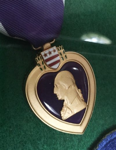The purple heart awarded to Charles Holcomb for his service during WWII.