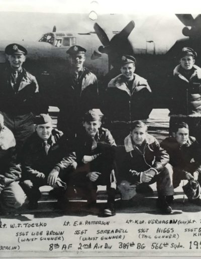 Charles Holcomb, bottom row far right, with his crew in front of a B-24 bomber in a photo from 1944.