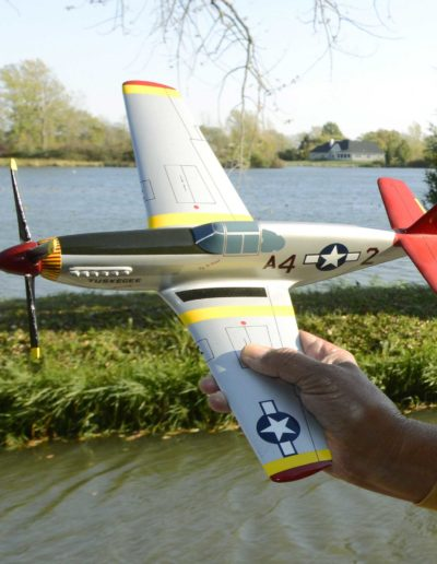Harold H. Brown holds a model of the P-51 C Mustang, the plane he flew as a WWII combat fighter in Europe.