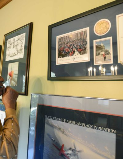 Harold H. Brown looks at the Congressional Gold Medal awarded to the Tuskegee Airmen he received at the United States Capitol in 2007.