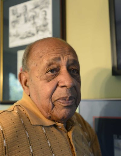 Harold H. Brown stands next to honors he received for his service as a Tuskegee Airman combat fighter in WWII.