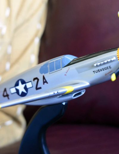 Harold H. Brown shows a model of the P-51 C Mustang, the plane he flew as a combat fighter in Europe.