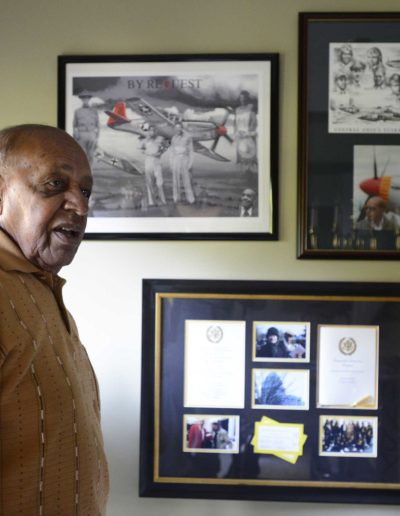 Harold H. Brown displays honors he received for his service as a Tuskegee Airman combat fighter in WWII.