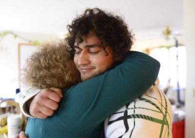 Richie Webber, 24, of Clyde hugs his mom, Cindy Weller, who has supported him through his addiction and recovery. A high school track star and good student, Webber got hooked on pain killers after a football injury. His addiction led him to heroin use.