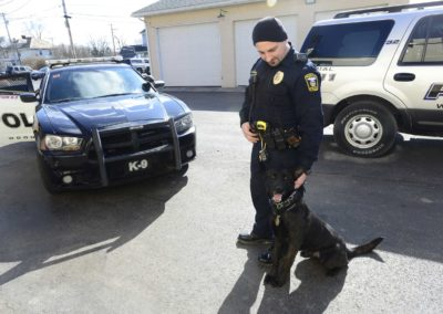Heroin related crimes in Woodville and other Sandusky County communities has risen dramatically since 2013. Officer Steve Gilkerson works with a drug sniffing dog named Raider to make arrests. Heroin-related burglaries and forced home entries shot up as more residents started using the drug, which is cheaper and more accessible than prescription pills and painkillers.