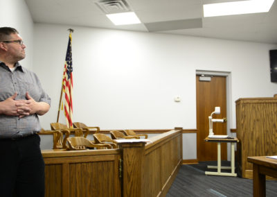 Probation officer Jeremy Greene looks on as Judge John Kolesar holds drug court in Clyde. About 30 people have gone through drug court since its inception, with five of them graduating.