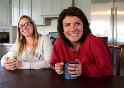 """Recovering heroin addict Alexandria Lowery, 26, left, and recovering meth addict Ashley Ammerman, 23, support each other in sobriety at Light House Sober Living in Port Clinton. """"I came here because I wanted that second chance,"""" Ammerman said."""
