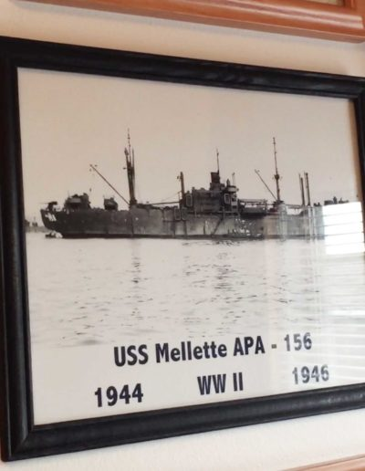 """Hanging in James Reardon's home is a photo of the USS Mellette APA-156, the attack transport ship he brought back to the states after the surrender. """"Our ship was in pretty bad shape,"""" Reardon said."""