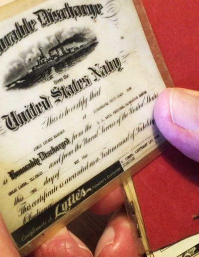 """James Reardon holds the card he was issued after honorably discharged. """"You used to have to carry those,"""" Reardon said."""