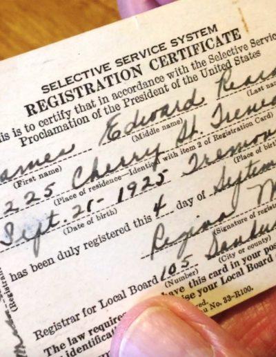 James Reradon holds his Selective Service System registration certificate.