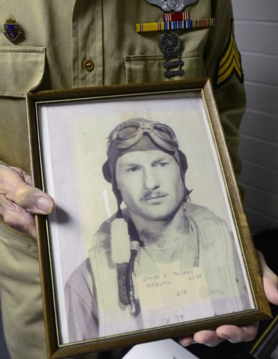 Jim McGrady holds a picture of himself from 1944 when he used to fly a B-24 Bomber.