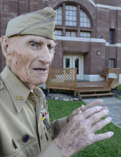 Jim McGrady stands in front of the Old Armory where he trained for his service.
