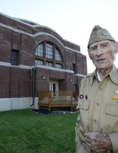 Jim McGrady stands in front of the Old Armory in Fremont where he trained for his service.