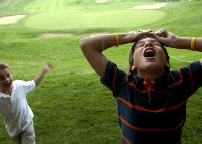 Cousins Collin Meyers, left, 7, of Littleton and Hunter Baumgarten, 11, of Highlands Ranch play during a rain delay of the PGA International Golf Tournament at Castle Pines in Castle Rock, Colo.
