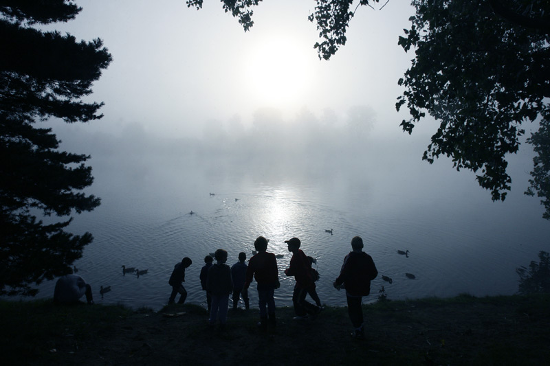 Children play in early morning fog at Olander Park in Sylvania, Ohio.