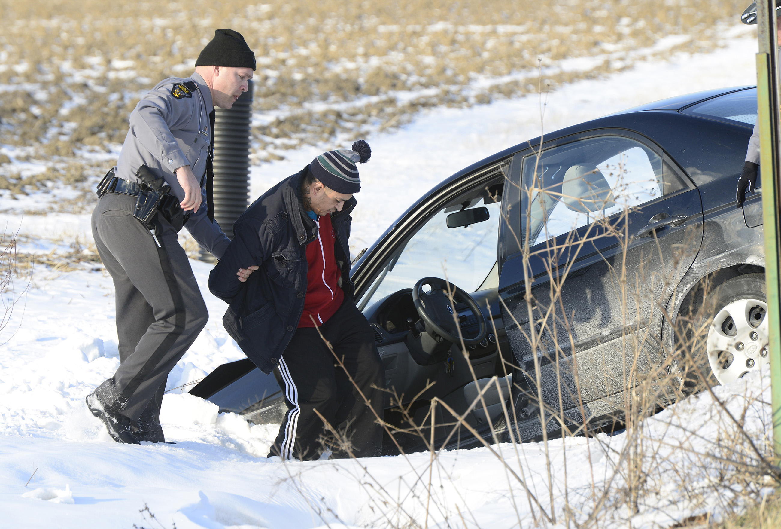 Ismael Gonzalez, 38, of Findlay is arrested on a felony warrant after leading police on a high-speed chase across three counties, ending with parts flying off the car and a crash into the ditch at the corner of County Roads 153 and 106 in Lindsey on Tuesday afternoon.