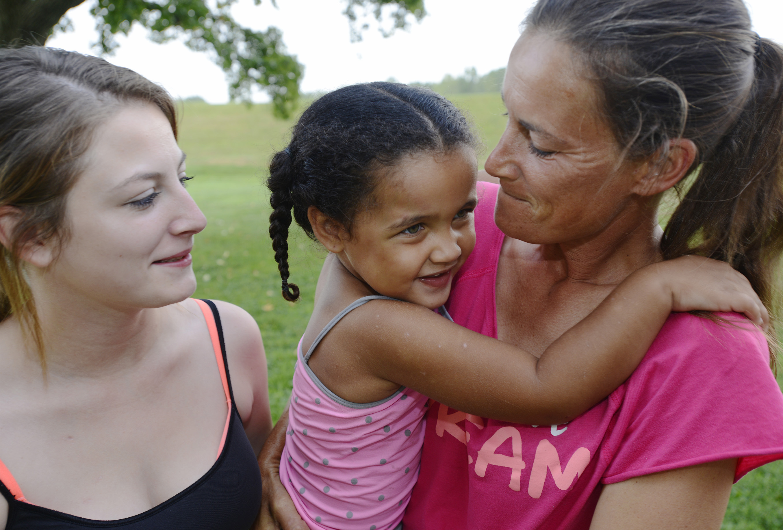Three months after being shot by her boyfriend, Devin Liggins, who then killed himself, Chelsea Vasquez, from left, finds strength in their daughter together, Kamiya, 3, and with her mother Candy Rodriguez. Vasquez has undergone extensive surgeries to remove her spleen, part of her pancreas and half her liver, and has physical therapy three times a week.