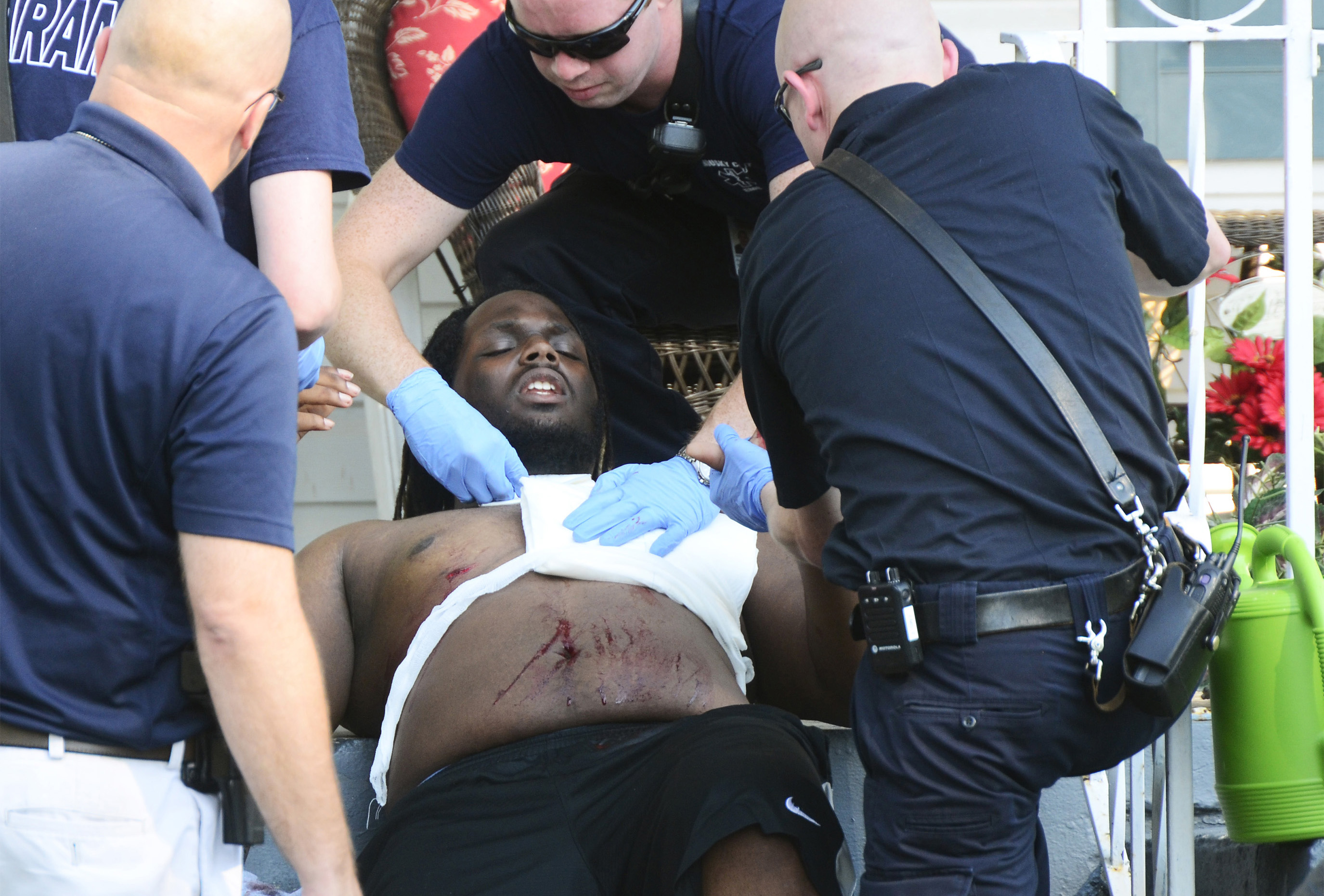 Evan Jerome Conley of Fremont is transported to the hospital after he was allegedly stabbed by his brother, Philip Eric Conley, over a social media post on Second Street in Fremont.