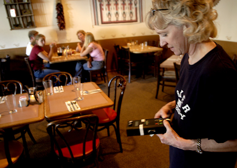 Piper's mom, Kathy Rainen, tests the UV levels in a Mexican restaurant near their home in Keystone, Colo., while Piper waits in the car. The UV reading was low enough to be safe for Piper, and she was able to go inside for dinner.