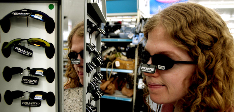 A necessity for her, Piper tries on sunglasses with 100 percent UV protection at Wal-Mart. She bought three pairs because she frequently loses them.