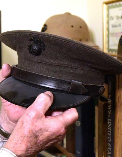 Willer shows his dress helmet he kept from World War II.