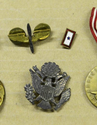Robert Parman shows keepsakes from his service in WWII.