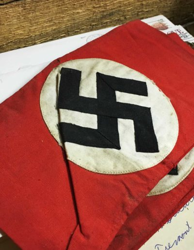 Robert Parman took a Nazi armbands from a German home he stayed in during World War II.