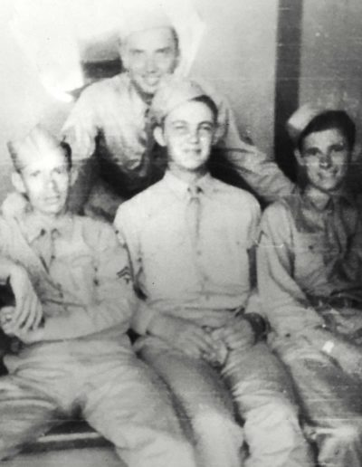 Robert Parman, bottom row middle, was 18 years old when he was drafted into WWII. He was 21 years old when he was discharged.