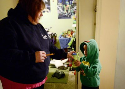 Tae's mother, BrandyLagasse, gives him medicine at 6 a.m. the morning of a biweekly chemotherapy treatment session. The drive from Port Clinton to Cleveland will take two-and-a-half hours, due to heavy traffic.