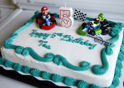 """Diontae """"Tae"""" Smith has a Mario theme cake to celebrate his fifth birthday. Tae's brain tumor covered a good portion of the right side of his brain, and he had surgery to remove it in April 2015."""