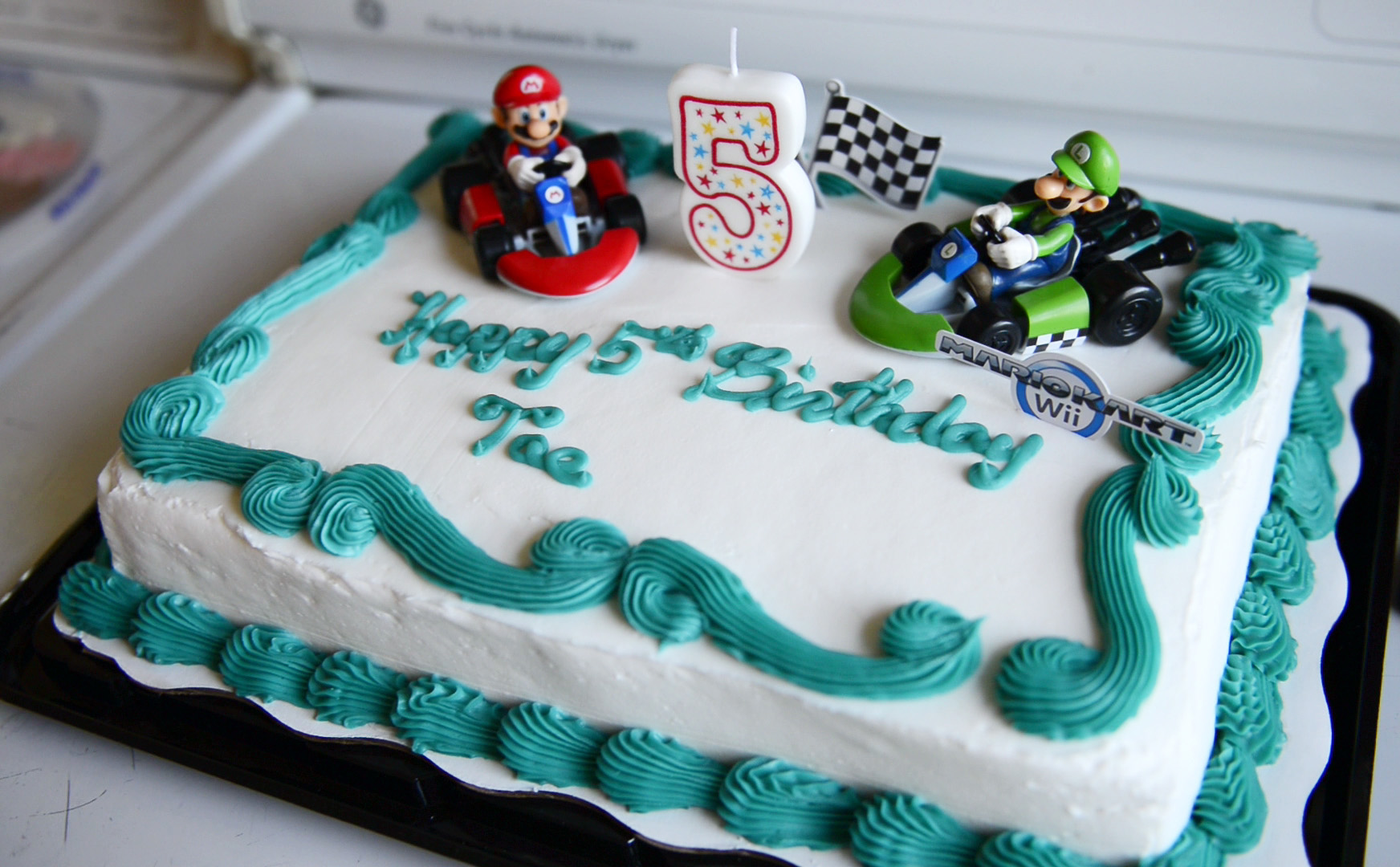 """Diontae """"Tae"""" Smith has a Mario theme cake to celebrate his fifth birthday. He has stage four glioblastoma, a form of aggressive brain cancer with a low survival rate, generally considered incurable."""