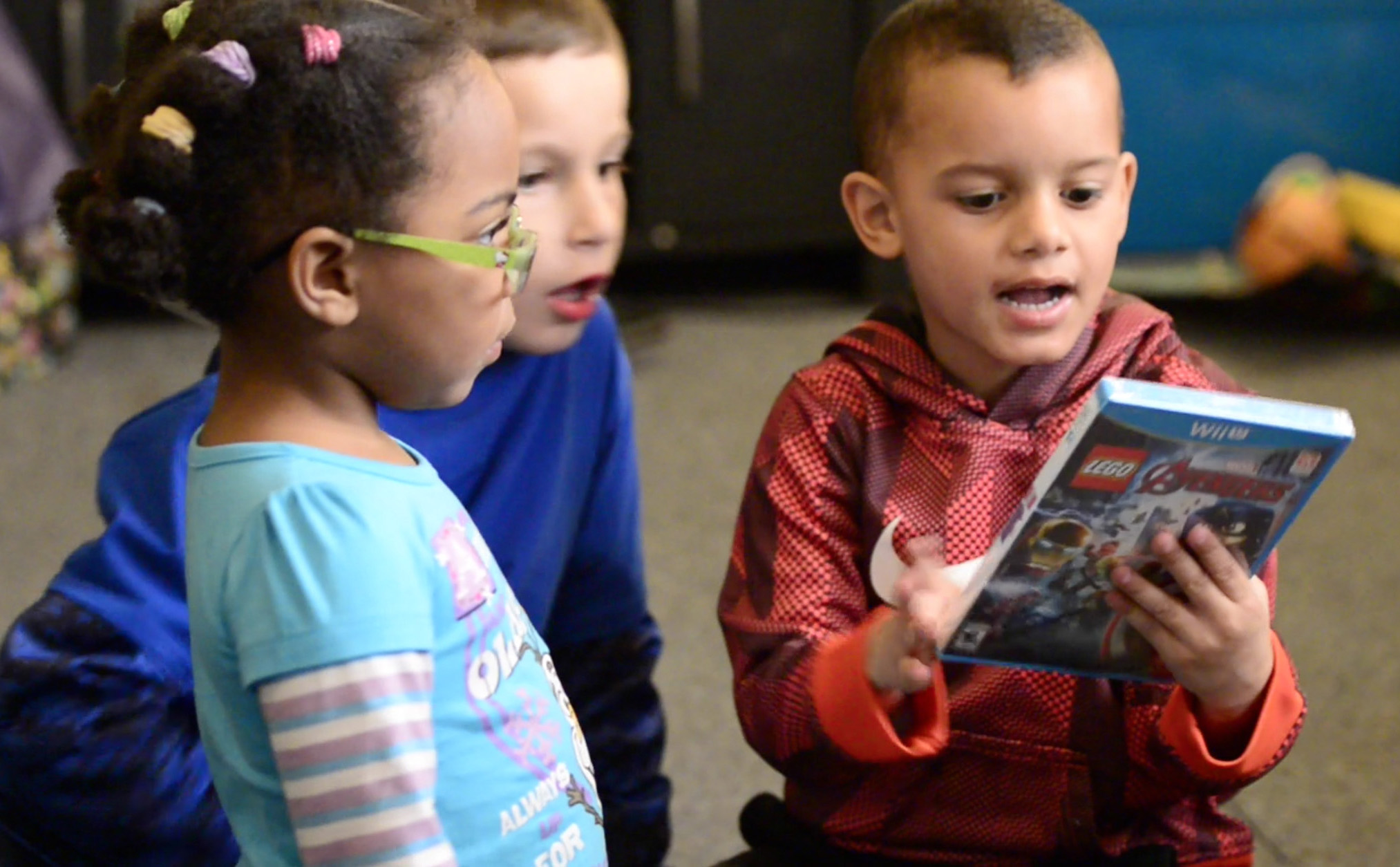 Tae, from right, opens presents with friends Malachi Pavlick, 7, and Kaliyah Boggs, 2. MRI scans in January and February revealed white spots that could be tumor regrowth on Tae's brain.