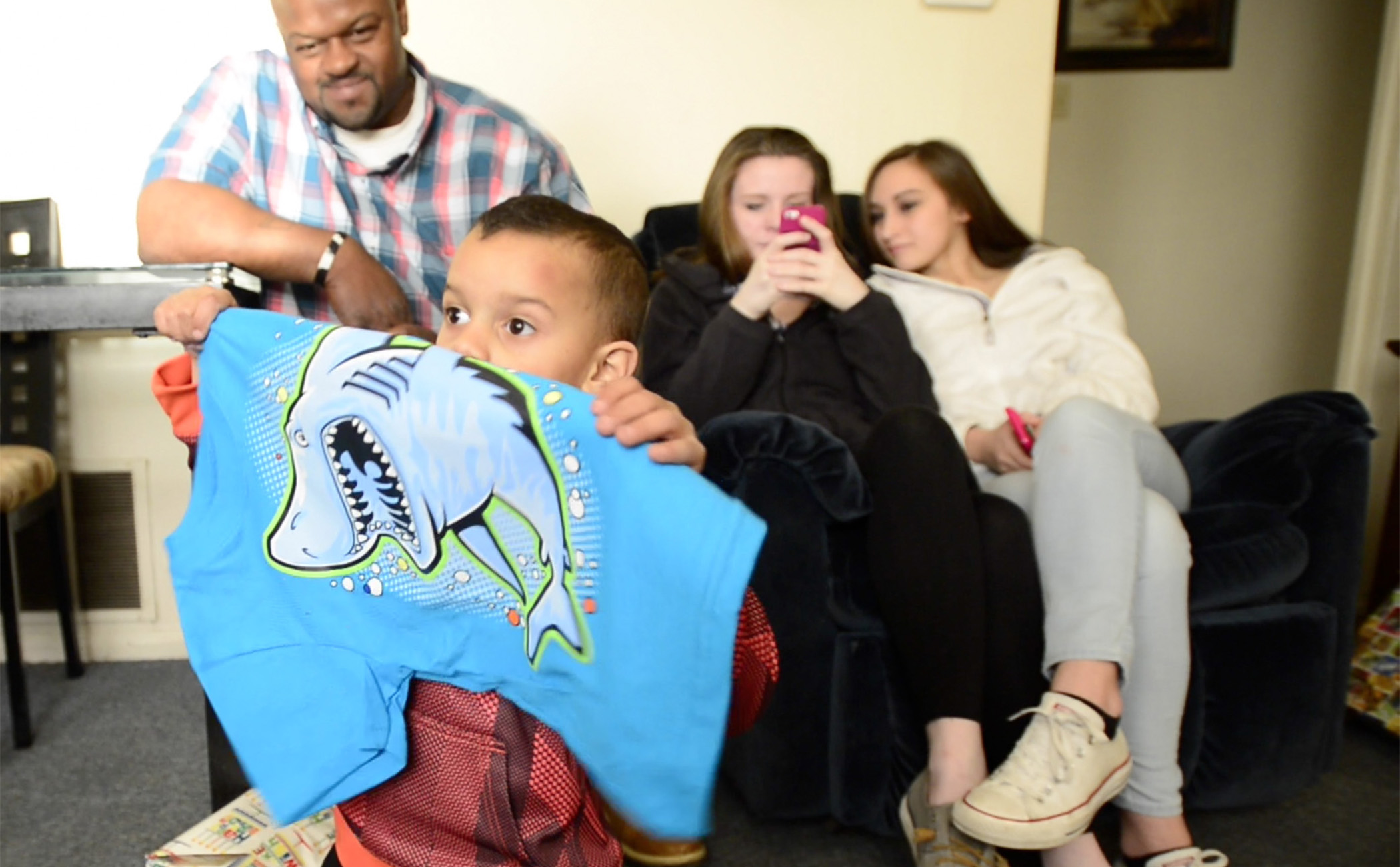 Brandy Lagasse, Tae's mother, takes pictures of him opening his presents. Doctors told the family a second surgery could cause the brain cancer to spread faster through Tae's body.