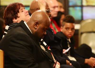 """Brandy Lagasse, left, and Alex Smith, Tae's parents, mourn him at a funeral in Findlay. """"He would scream,"""" Brandy said, """"'I'm your child. You don't leave your child. I'm just a child. I don't deserve this.'"""""""