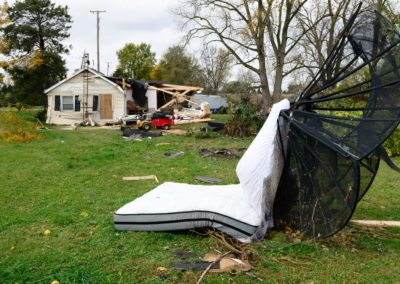 Connie Weyer's parents were in the living room when the tornado hit. They described the tornado as sounding like a whistle which only lasted a few seconds. The force of the wind blew Connie's mother's bedroom door shut. The door then blew open, and when they looked out the bedroom was gone. Connie's mother's mattress was blown halfway across the yard.