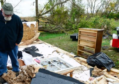 Kevin Weyer looks at the damage an EF 1 tornado did on Nov. 5, 2017 to his in-laws' home where he lives in Townsend Township. Three weeks before the tornado hit, a fire destroyed the family's barn which included five vintage cars and a vintage motorcycle.