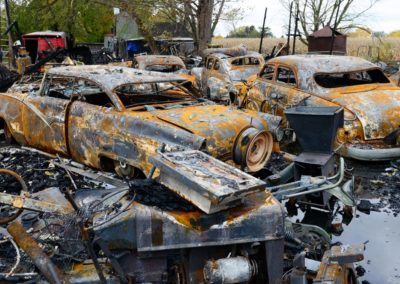 Three weeks before the Oct. 5 tornado, a fire burned down the Weyer's 95' x 45' pole barn. Kevin Weyer walks through the ashy, burnt out shells of vintage cars that sit uncovered amid the ruins of their barn. Lost in the fire was an antique '76 bicentennial liberator edition Harley Davidson motorcycle, and antique cars that included a '50 Mercury, '56 Ford, '48 Ford, '50 Ford, and '67 Mustang convertible owned by his in-laws who own the house.