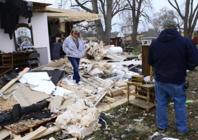 Connie Weyer, left, and her husband, Kevin, look at the damage an EF 1 tornado did on Nov. 5, 2017 to Connie's parents home where they live in Townsend Township. Three weeks before the tornado hit, a fire destroyed the family's barn which included five vintage cars and a vintage motorcycle.