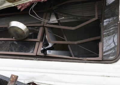 The force of the tornado picked up the Weyer's 32-foot Coachman camper, lifted it over a 10-foot deck and overturned it on its side.