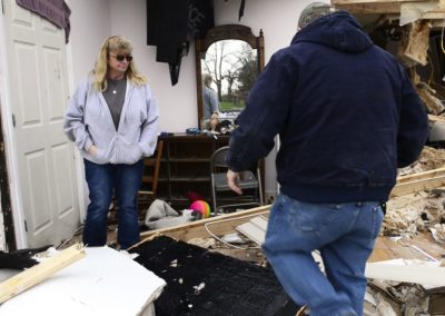 Connie Weyer, left, and her husband, Kevin, look at the damage an EF 1 tornado did on Nov. 5, 2017 to Connie's parents home where they live in Townsend Township. A fire three weeks before destroyed the barn including five vintage cars and a vintage motorcycle.