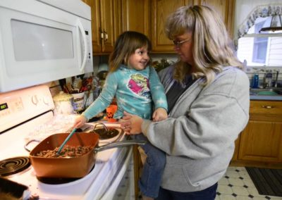 Connie Weber asks her 3-year-old granddaughter, Kaydee Weber, if she was scared when the tornado hit. The family was bowling in Sandusky when the tornado hit the house. Connie said that her granddaughter is too young to understand fully what happened.