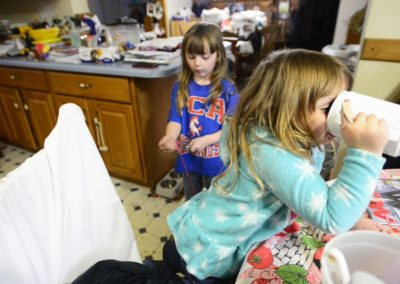 """Five-year-old Becca Weyer, left, and her sister, Kaydee, 3, were bowling in Sandusky when the tornado hit the house. They used to run in a circle through the section of the house that was blown away by the tornado. """"I thank the Lord that we weren't home,"""" their grandmother, Connie Weyer, said. """"They would have been in that."""""""