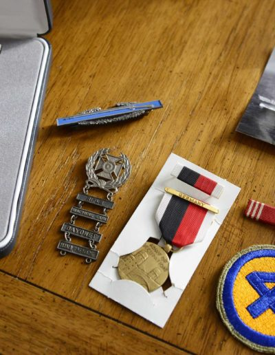 Walter Auxter's metals and honors, ribbon bars with stars, combat infantry badge and 44th division patch.